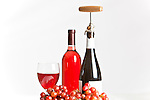 Two Wine Bottles, grapes, and Glass, pinot, merlot, blush, zinfandel, light  to dark red.  White background.