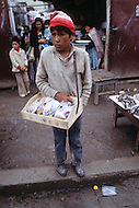 Children street vendors in La Paz, Bolivia - Child labor as seen around the world between 1979 and 1980 - Photographer Jean Pierre Laffont, touched by the suffering of child workers, chronicled their plight in 12 countries over the course of one year.  Laffont was awarded The World Press Award and Madeline Ross Award among many others for his work.