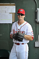 Center fielder Andrew Benintendi (2) gets ready in the dugout prior to his first home game against the Greensboro Grasshoppers on Tuesday, August 25, 2015, at Fluor Field at the West End in Greenville, South Carolina. Benintendi is a first-round pick of the Boston Red Sox in the 2015 First-Year Player Draft out of the University of Arkansas. Greensboro won, 3-2. (Tom Priddy/Four Seam Images)