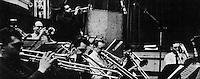 The Brass: Trumpeters Harry Edison, Bernie Glow, Art Farmer (standing), Markie Markowitz (nearly hidden behind Farmer); and trombonists Bob Brookmeyer, Frank Rehab, Earl Swope, Jimmy Cleveland, and Rod Levitt.