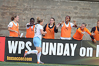 Ella Masar goes over to the sideline to greet her teammates after her first goal in a 2-1 win over the Boston Breakers.