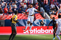DENVER, CO - JUNE 3: Antony Lozano #9 of Honduras goes up for a header during a game between Honduras and USMNT at Empower Field at Mile High on June 3, 2021 in Denver, Colorado.