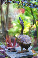 Whimsical Iron duck ovarlooking California plant collector garden - Carol Brant