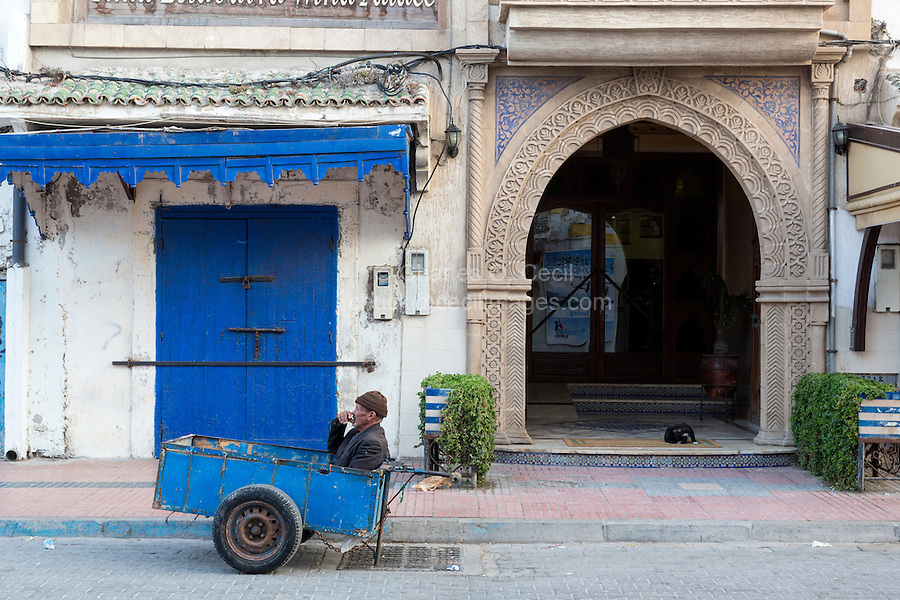 Essaouira, Morocco.  A Porter with his Two-wheeled cart Waits in the Medina for a Shopper in need.  Motorized vehicles are prohibited.