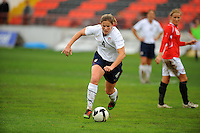 Cat Whitehill charges upfield. The USA defeated Norway 2-1 at Olhao Stadium on February 26, 2010 at the Algarve Cup.