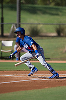 Rylan Bannon (13) of the Los Angeles Dodgers follows through on his swing during an Instructional League game against the Chicago White Sox on September 30, 2017 at Camelback Ranch in Glendale, Arizona. (Zachary Lucy/Four Seam Images)