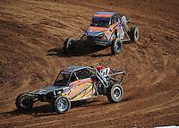Mar. 19, 2011; Chandler, AZ, USA;  LOORRS pro buggy unlimited driver Eddie Tafoya leads Phil Bollman during round one at Firebird International Raceway. Mandatory Credit: Mark J. Rebilas-