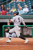 Jackson Generals third baseman Juniel Querecuto (9) follows through on a swing during a game against the Chattanooga Lookouts on May 9, 2018 at AT&T Field in Chattanooga, Tennessee.  Chattanooga defeated Jackson 4-2.  (Mike Janes/Four Seam Images)