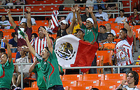 Mexican Fans cheering after Monarcas Morelia scored a goal to tie the game. Monarcas Morelia tied DC United 1-1 in the SuperLiga opening match in group B, at RFK Stadium in Washington DC, Wednesday July 25, 2007.
