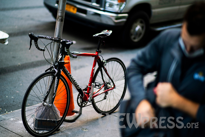 NEW YORK, NY - OCTOBER 15: A bicycle is seen locked at a pole at Times Square on October 15, 2020 in New York, At least 4,477 bicycles have been reported stolen with an increase of 27 percent from same period last year, according to the police. (Photo by Eduardo MunozAlvarez/VIEWpress)