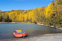 A raft is beached on a falltime turn along the  upper Kenai River.
