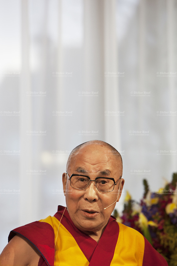 """Switzerland. Basel. His Holiness the Dalai Lama during a press conference at Grand Hotel Les Trois Rois. The 14th and current Dalai Lama is Tenzin Gyatso, recognized since 1950. He is the current Dalai Lama, as well as the longest-lived incumbent, well known for his lifelong advocacy for Tibetans inside and outside Tibet. Dalai Lamas are amongst the head monks of the Gelug school, the newest of the schools of Tibetan Buddhism. The Dalai Lama, also called """" Ocean of Wisdom"""" is considered as the incarnation of Chenresi, the Bodhisattva of compassion who is also the protective deity of Tibet. 7.02.2015 © 2015 Didier Ruef"""