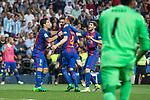Ivan Rakitic, Luis Suarez  and Leo Messi  of FC Barcelona celebrates after scoring a goal during the match of La Liga between Real Madrid and Futbol Club Barcelona at Santiago Bernabeu Stadium  in Madrid, Spain. April 23, 2017. (ALTERPHOTOS)