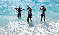 16 SEP 2012 - NICE, FRA - David Hauss, Anthony Pujades and Pierre Le Corre of Les Sables Vendee Triathlon prepare for a warm up swim before the start of the French Grand Prix triathlon series final stage held during the Triathlon de Nice Côte d'Azur .(PHOTO (C) 2012 NIGEL FARROW)