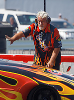Sep 4, 2016; Clermont, IN, USA; Chuck Worsham , crew chief for NHRA funny car driver Jim Campbell during qualifying for the US Nationals at Lucas Oil Raceway. Mandatory Credit: Mark J. Rebilas-USA TODAY Sports