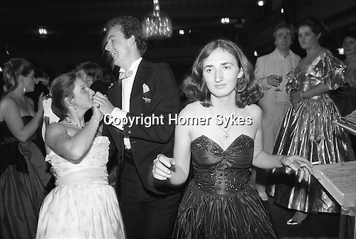 Westminster, London. 1982<br /> With the customary cigarette in hand, a lone Sloane Ranger takes to the dance floor to sashay the night away at the annual charity Rose Ball, held in the Grosvenor House Hotel, Park Lane.