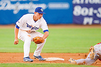 Ogden Raptors shortstop Corey Seager (46) waits to apply the tag to Joel Capote (17) of the Orem Owlz as he attempts to steal second base at Lindquist Field on July 28, 2012 in Ogden, Utah.  The Raptors defeated the Owlz 8-7.   (Brian Westerholt/Four Seam Images)
