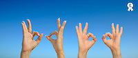 Woman and man making 'OK' hand sign on blue sky (Licence this image exclusively with Getty: http://www.gettyimages.com/detail/103301315 )