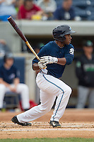West Michigan Whitecaps outfielder Rashad Brown (25) follows through on his swing against the Dayton Dragons on April 24, 2016 at Fifth Third Ballpark in Comstock, Michigan. Dayton defeated West Michigan 4-3. (Andrew Woolley/Four Seam Images)