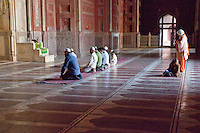 Agra, India.  Taj Mahal Mosque.  Worshippers at Mid-day Prayer.  Note Women and small girl in rear.