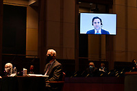 Aaron Zelinsky, on screen, a career Justice Department prosecutor who was part of special counsel Robert Mueller's team and worked on the case against Roger Stone, testifies remotely before the House Judiciary Committee on Capitol Hill in Washington, Wednesday, June 24, 2020, during a hearing on oversight of the Justice Department and a probe into the politicization of the department under Attorney General William Barr. Also testifying in person is former Attorney General Michael Mukasey, left, and former Deputy Attorney General Donald Ayer, second from left.<br /> Credit: Susan Walsh / Pool via CNP/AdMedia