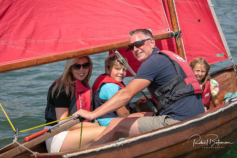 Gary Mills and family in their Rankin dinghy in Cork Harbour