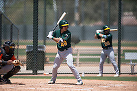 Oakland Athletics catcher Iolana Akau (49) at bat during an Extended Spring Training game against the San Francisco Giants Orange at the Lew Wolff Training Complex on May 29, 2018 in Mesa, Arizona. (Zachary Lucy/Four Seam Images)