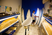 Eric Arakawa in his shaping room at his surfboard factory in the old Waialua Sugar Mill