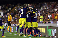 Valencia, Spain. Thursday 19 September 2013<br /> Pictured: Jonathan de Guzman of Swansea mobbed by team mates celebrating his goal, making the score 0-3 to his team<br /> Re: UEFA Europa League game against Valencia C.F v Swansea City FC, at the Estadio Mestalla, Spain,