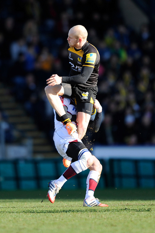 Joe Simpson of London Wasps receives a yellow card for his challenge on Nick MacLeod of Sale Sharks during the Aviva Premiership match between London Wasps and Sale Sharks at Adams Park on Saturday 1st March 2014 (Photo by Rob Munro)