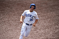 Duke Blue Devils designated hitter Rudy Maxwell (26) hustles to third base against the Liberty Flames in NCAA Regional play on Robert M. Lindsay Field at Lindsey Nelson Stadium on June 4, 2021, in Knoxville, Tennessee. (Danny Parker/Four Seam Images)