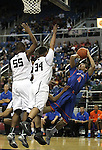 Bishop Gorman's Trey Kennedy gets fouled during the NIAA 4A State Basketball Championship game between Bishop Gorman and Hug high schools at Lawlor Events Center, in Reno, Nev, on Friday, Feb. 24, 2012. Bishop Gorman won 96-51..Photo by Cathleen Allison