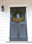 """Door Christmas wreath Colonial Williamsburg Virginia historic district 1699 to 1780 which made colonial Virgnia's Capital, for most of the 18th century Williamsburg was the center of government education and culture in Colony of Virginia, George Washington, Thomas Jefferson, Patrick Henry, James Monroe, James Madison, George Wythe, Peyton Randolph, and others molded democracy in the Commonwealth of Virginia and the United States, Motto of Colonial Williamsburg is """"The furture may learn from the past,"""""""