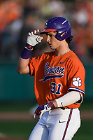 Center fielder Bryce Teodosio (31) of the Clemson Tigers tips his helmet after scoring his first collegiate run in a game against the William and Mary Tribe on February 16, 2018, at Doug Kingsmore Stadium in Clemson, South Carolina. Clemson won, 5-4 in 10 innings. (Tom Priddy/Four Seam Images)