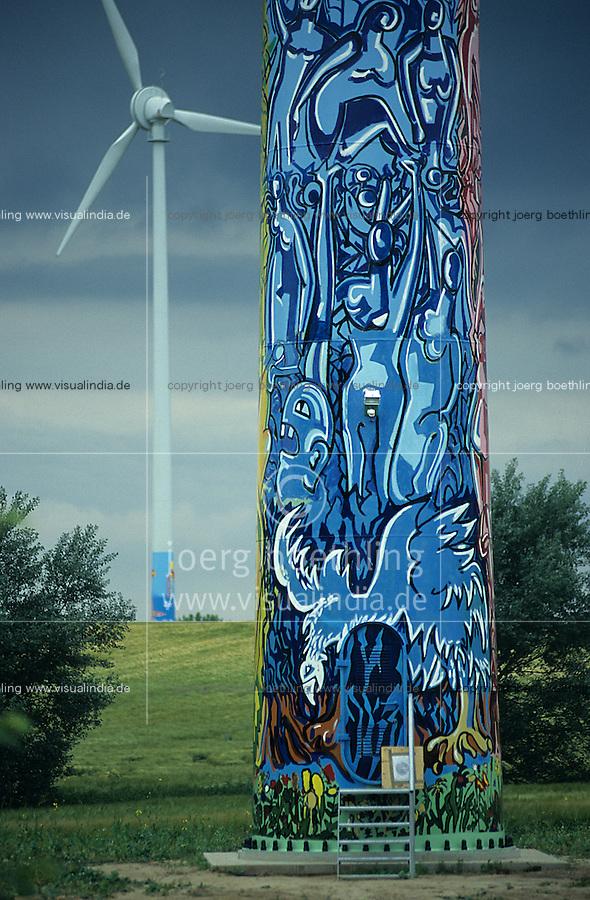 GERMANY Lübow, windmill enercon E-66 with art painting of artist near Wismar / DEUTSCHLAND, Windpark mit von Künstler bemalten Enercon E-66 Windräder in Lübow bei Wismar