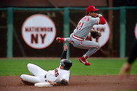 SAN FRANCISCO, CA - Barry Larkin of the Cincinnati Reds turns a double play at second base during a game against the San Francisco Giants at Candlestick Park in San Francisco, California in 1990. Photo by Brad Mangin