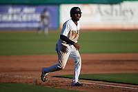 Johan Lopez (32) of the Charleston RiverDogs takes his lead off of third base against the Augusta GreenJackets at Joseph P. Riley, Jr. Park on June 27, 2021 in Charleston, South Carolina. (Brian Westerholt/Four Seam Images)