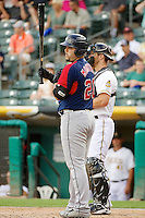 Jesus Montero (20) of the Tacoma Rainiers at bat against the Salt Lake Bees in Pacific Coast League action at Smith's Ballpark on July 9, 2014 in Salt Lake City, Utah.  (Stephen Smith/Four Seam Images)