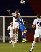 Shannon Boxx of USA (L) and Wendy Pineda of Guatemala (R) at the 2010 CONCACAF Women's World Cup Qualifying tournament held at Estadio Quintana Roo in Cancun, Mexico.