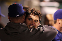 Texas Rangers second baseman Ian Kinsler #5 is greeted by teammates during a game against the Los Angeles Angels at Angel Stadium on September 27, 2011 in Anaheim,California. Texas defeated Los Angeles 10-3.(Larry Goren/Four Seam Images)