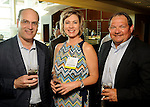 From left: John Littman, Lisa Groce and Tim Thomas at the Texas A&M Energy Institute reception at the West Club in Reliant Stadium Wednesday May 2,2012. (Dave Rossman Photo)