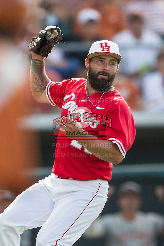Houston Cougars pitcher Tyler Ford (29) in action during the NCAA baseball game against the Texas Longhorns on June 6, 2014 at UFCU Disch–Falk Field in Austin, Texas. The Longhorns defeated the Cougars 4-2 in Game 1 of the NCAA Super Regional. (Andrew Woolley/Four Seam Images)