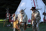 A Native American Indian encampment with two buckskinners