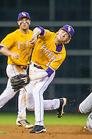 LSU Tigers second baseman Grayson Byrd (10) turns a double play during the Houston College Classic against the Nebraska Cornhuskers on March 8, 2015 at Minute Maid Park in Houston, Texas. LSU defeated Nebraska 4-2. (Andrew Woolley/Four Seam Images)