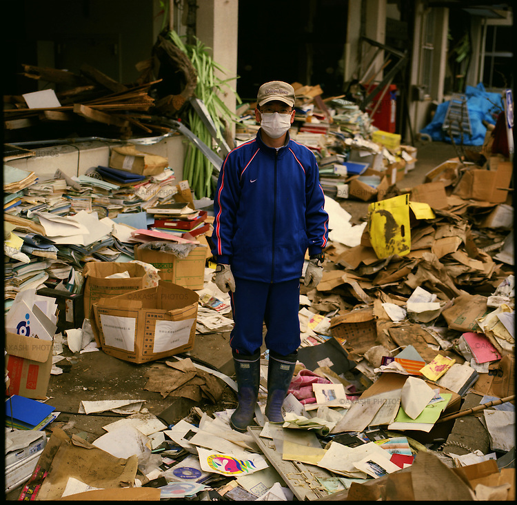 """Mr. Hiroki Abe, 48, a worker of city hall of Ofunato at Sanriku district, looks for missing documents in one month after the earthquake and tsunami. """"We saw the tsunami went over the water gate and fell like Niagara Falls on our town,"""" he said. They ran up the mountain behind the city hall. From the mountain, they saw the water swallowed the city hall. """"When the tsunami went away, it took away everything,"""" he said. """"It was horrible. I have never seen something like this.""""<br /> On March 11, 2011, the earthquake of magnitude 9.0, the biggest earthquake in the history of Japan and the fourth biggest earthquake in the world after year 1900, shocked the Tohoku area of Japan. In about 30 minutes, devastating tsunami reached, affecting the coastline with a length of 500 km (310 miles). The tsunami wave height of 39 meters (128 feet) was recorded in a port town in Tohoku. The tsunami swallowed villages along the coast and washed away all houses. The earthquake and tsunami killed more than 15,800 people, and still more than 3,500 people are missing."""