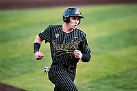 Vanderbilt Commodores second baseman Parker Noland (25) hustles towards home plate against the Tennessee Volunteers on Robert M. Lindsay Field at Lindsey Nelson Stadium on April 16, 2021, in Knoxville, Tennessee. (Danny Parker/Four Seam Images)