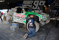 Nov. 4, 2011; Las Vegas, NV USA; A crew member works on the truck of LOORRS pro 2 unlimited driver Robby Woods during qualifying for round 13 at the Las Vegas Motor Speedway. Mandatory Credit: Mark J. Rebilas-