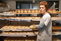 - holiday farm Cascina Raflazz in Paroldo (Cuneo), processing of Toma typical cheese, aging<br />