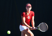 STANFORD, CA - MARCH 1, 2015--Stanford women's tennis player Taylor Davidson, return the ball back to a  CAL Berkley player during Sunday's match at  at the Taube Family Tennis Stadium.