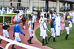 March 27 2021: Jockeys enter the paddock for the Dubai Kahayla Classic at Meydan Racecourse, Dubai, UAE. Shamela Hanley/Eclipse Sportswire/CSM